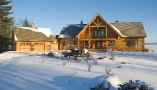 log home with square timber beams and d-cut log profiles