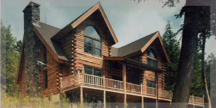 The adirondack is a loft style log cabin chalet treetop for Adirondack house plans